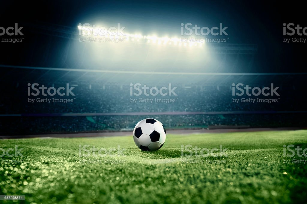 View of soccer ball on athletic field in stadium arena stock photo