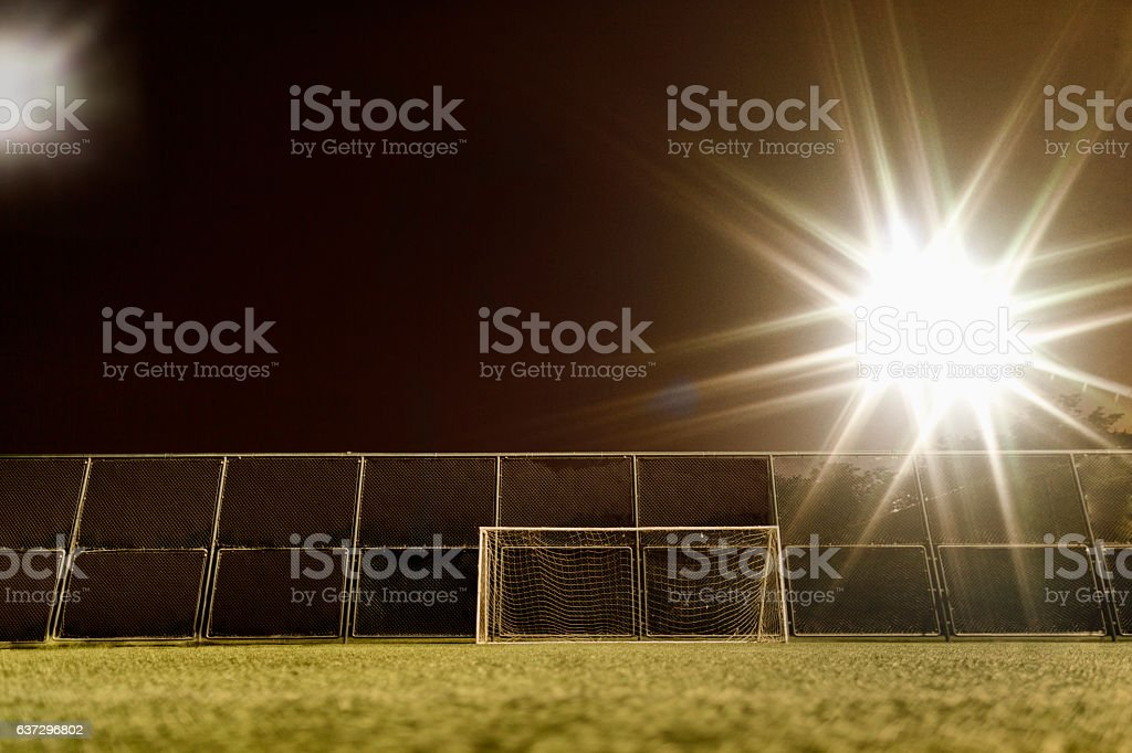 View of soccer field illuminated at night stock photo