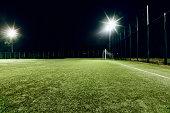 View of soccer field illuminated at night