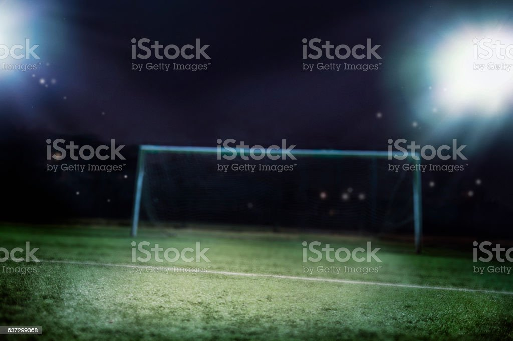 View of soccer field illuminated at night stock photo