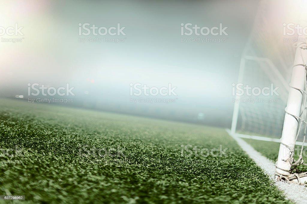 View of soccer field illuminated in hazy fog at night stock photo