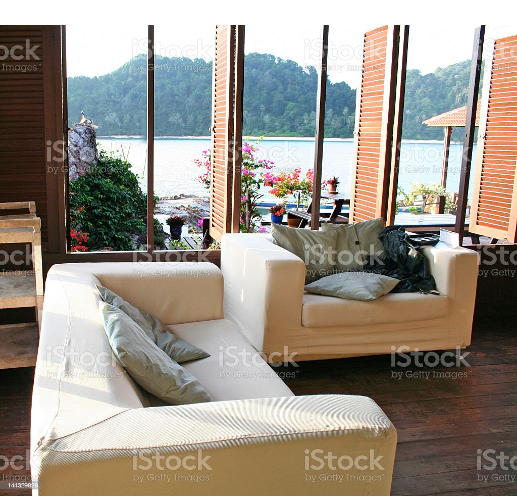 View of sofas and a view by the seaside royalty-free stock photo