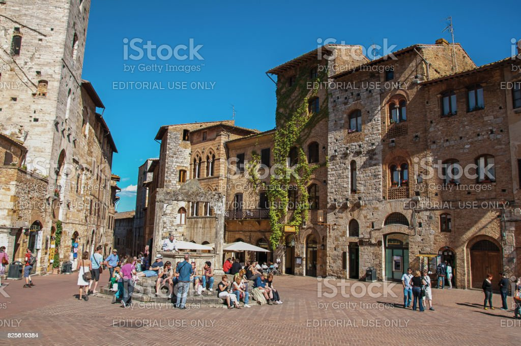 View of square with people, old buildings in San Gimignano stock photo