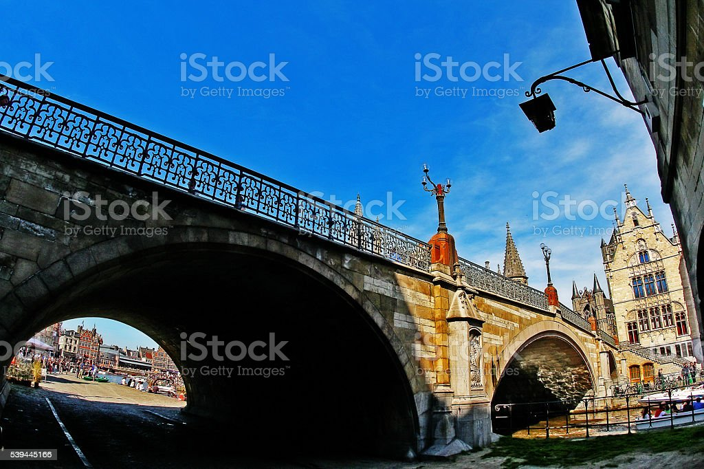 View of St. Michael Bridge (Sint-Michielsbrug) on Graslei Korenlei Streets stock photo