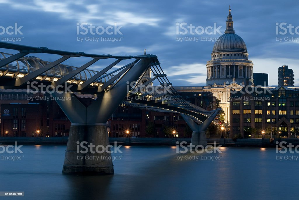 View of St Pauls and the Millenium Brige at dusk stock photo