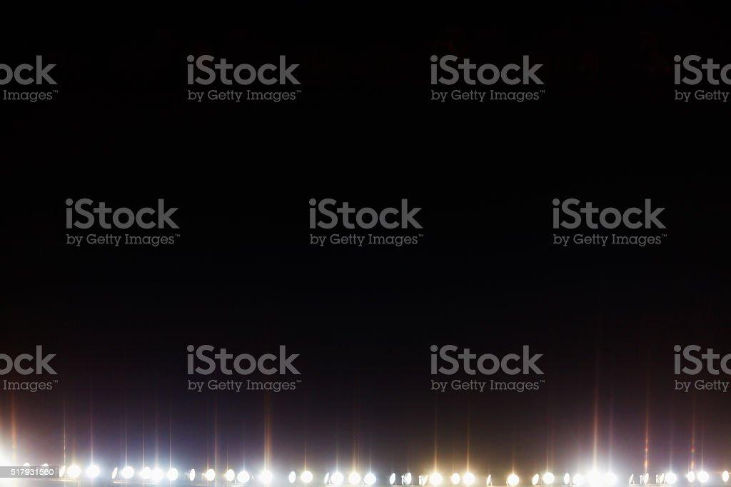 View of stadium lights at night stock photo