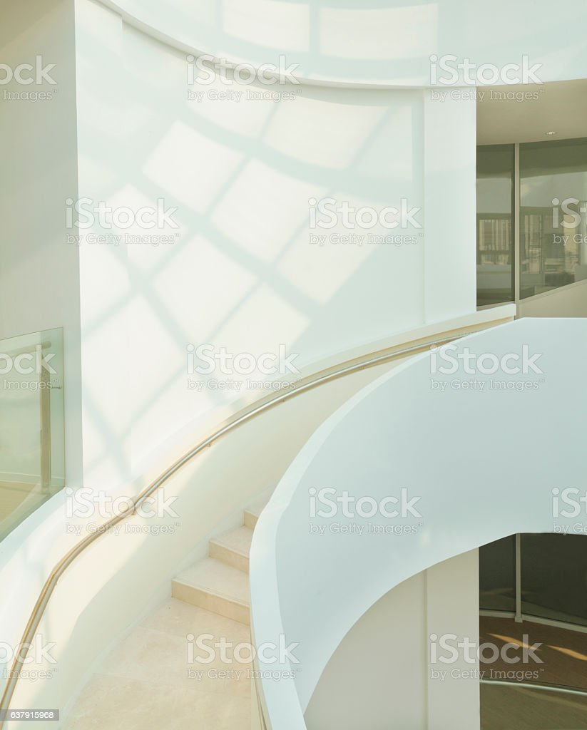 View of staircase with skylight shadows in modern building stock photo