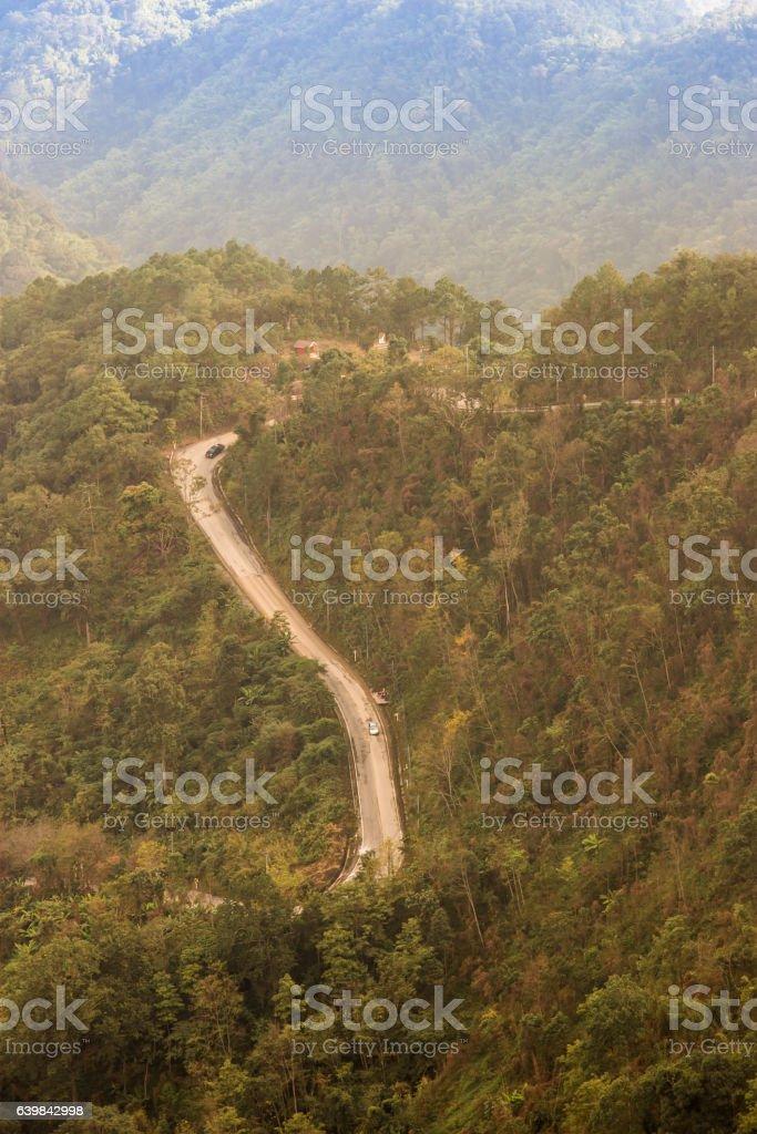 View of steep mountain road stock photo