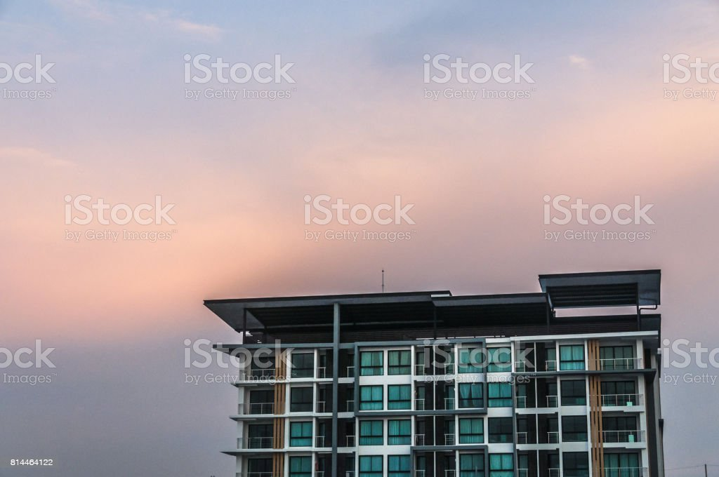 View of sunset behind the building stock photo
