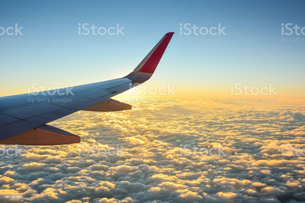 view of sunset sky from the airplane stock photo