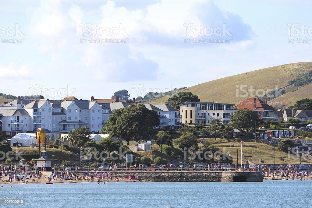 View of Swanage beach / coastline, English seaside town, sea, holiday-homes stock photo