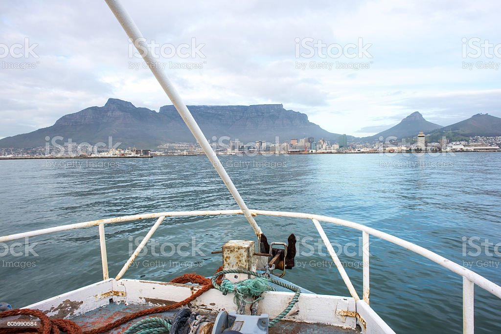 View of table mountain from the bow of boat stock photo