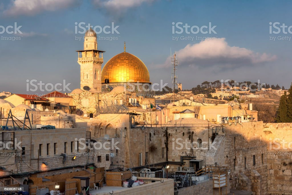 A view of Temple Mount in the old city of Jerusalem, including the Western Wall and golden Dome of the Rock stock photo