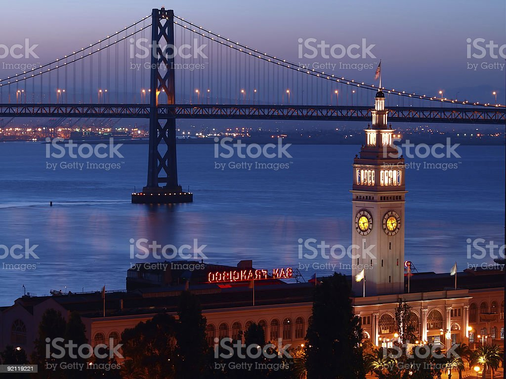 View of the a ferry with The Bay Bridge and night skies stock photo