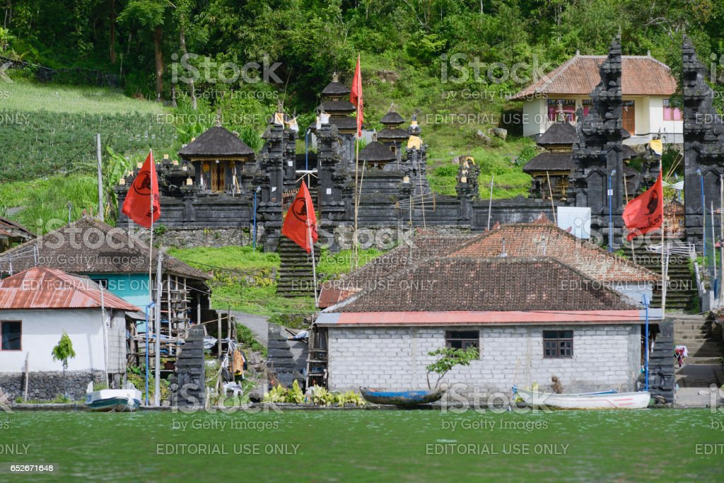 View of the ancient village Trunyan and Hindu Temple from Lake Batur, Bali, Indonesia stock photo