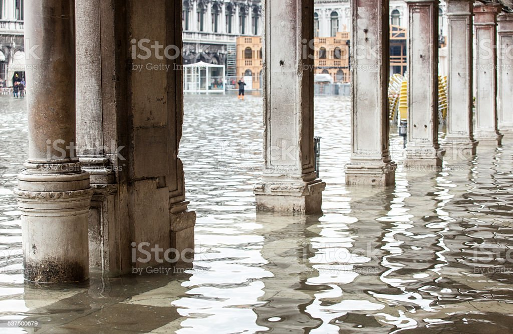 View of the arcades with high water in Venice. stock photo