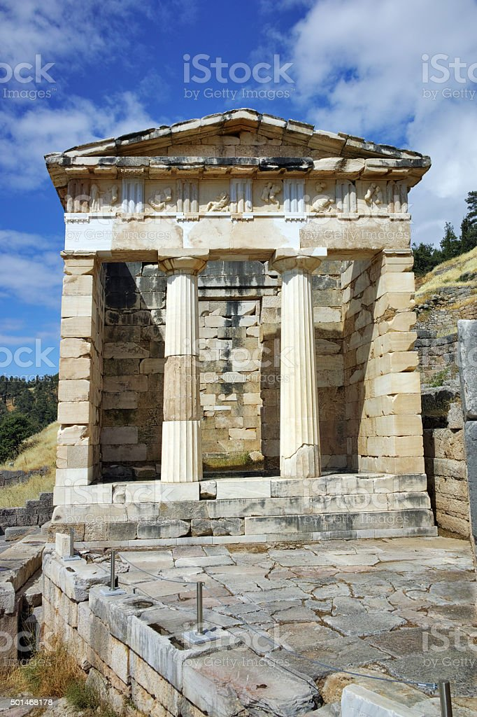 View of the Athenian Treasuryin Ancient Greek archaeological site of Delphi stock photo