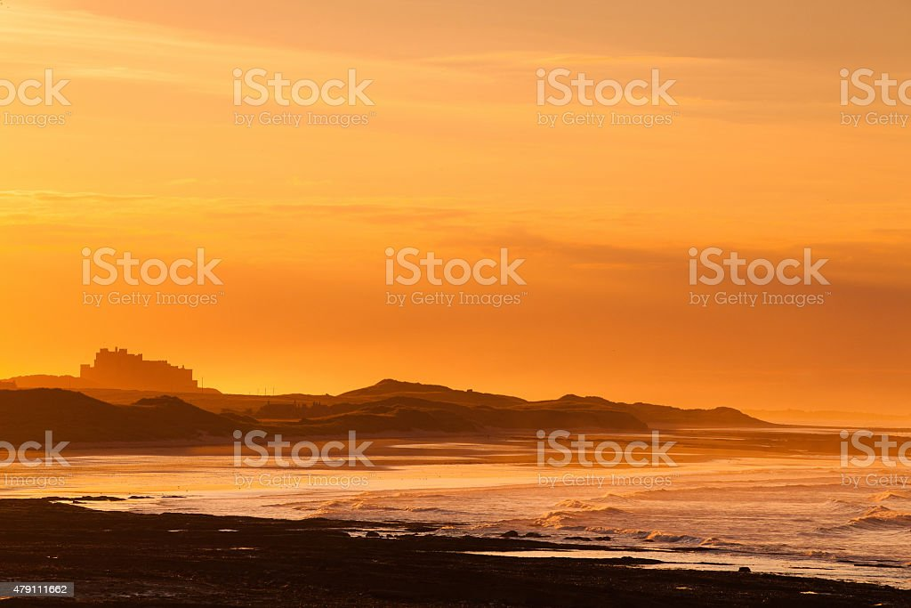 View of the  Bamburgh castle in a spectacular sunset stock photo