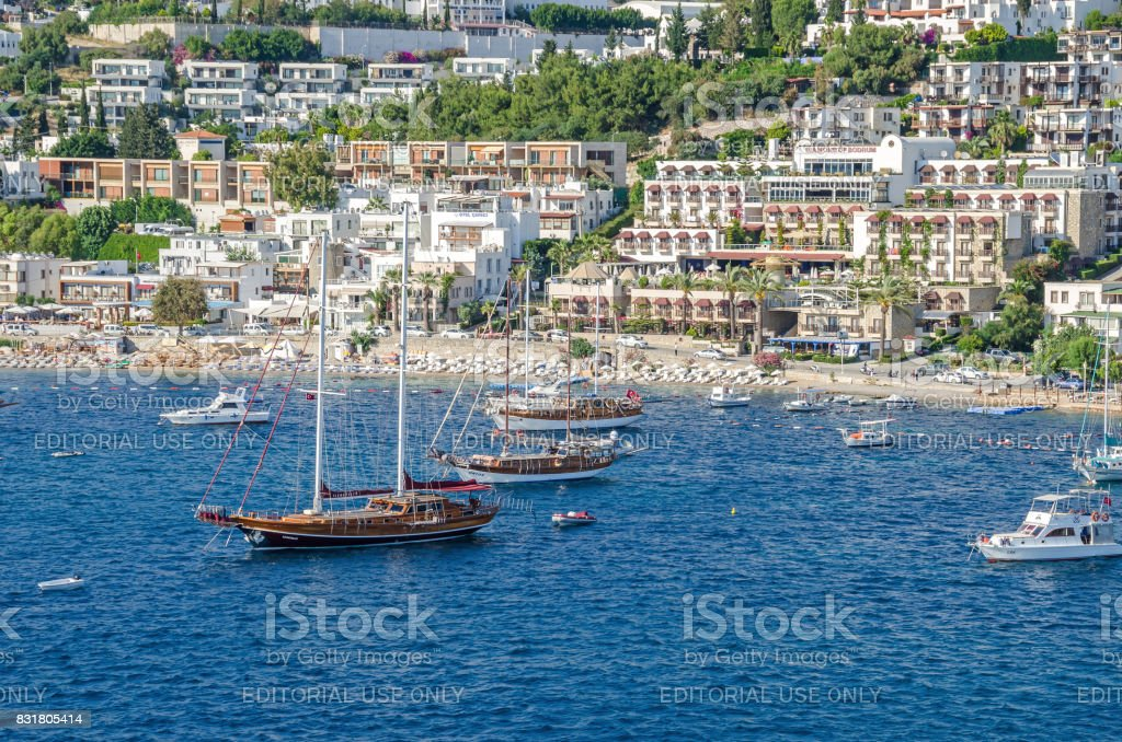 View of the beach of  Bodrum from the sea with the Gulet type schooners stock photo