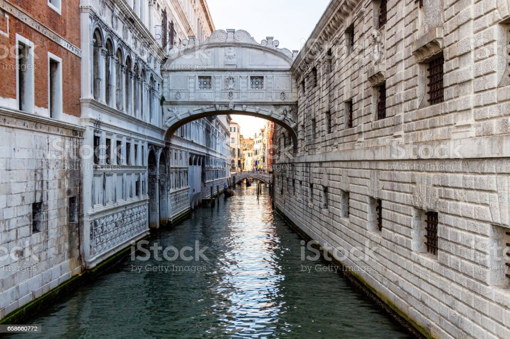 View of the canal with boats and gondolas in Venice, Italy. Venice is a popular tourist destination of Europe stock photo