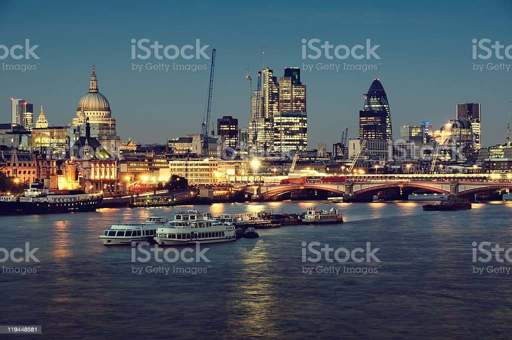 A view of the city of London skyline at nighttime stock photo