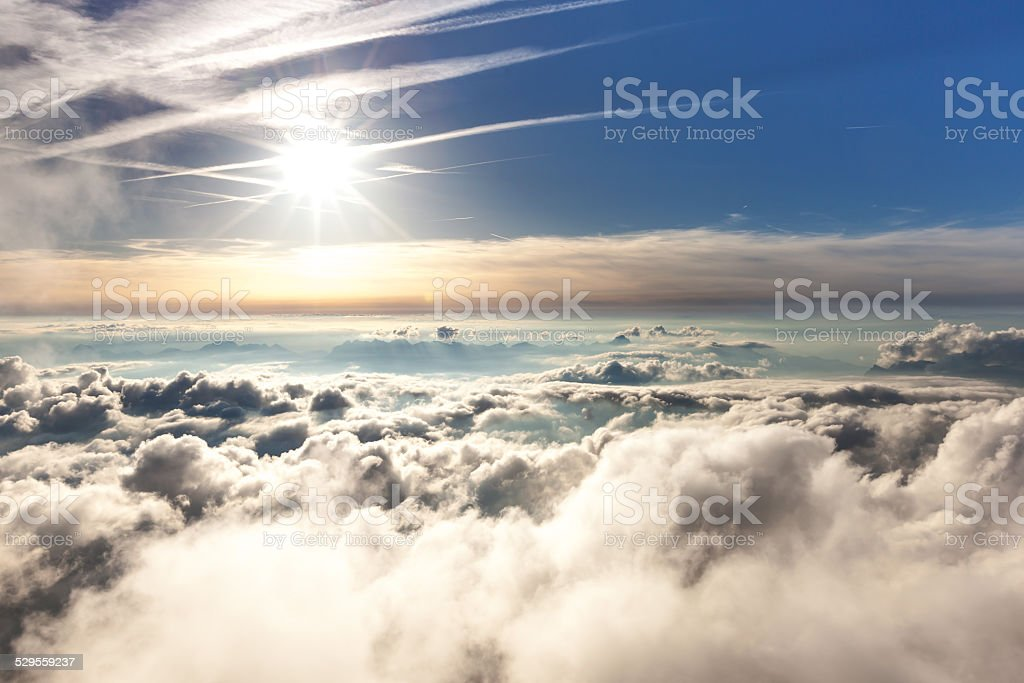 View of the clouds over the Alps stock photo