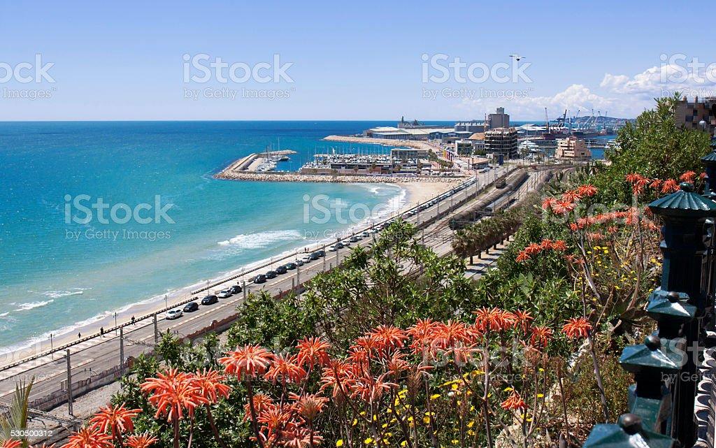 View of the coast Tarragona: sea, railway and petrochemical plan stock photo