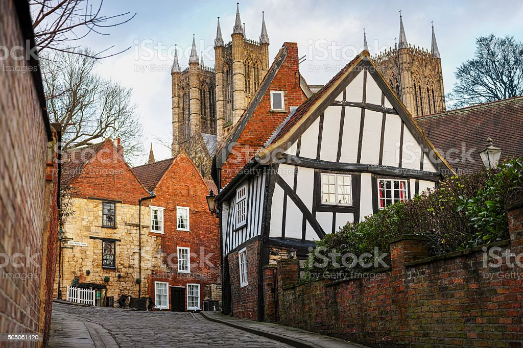 View of the 'Crooked House' with Lincoln Cathedral. stock photo