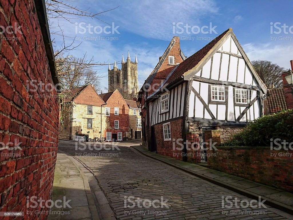 View of 'The Crooked House' with Lincoln Cathedral. stock photo