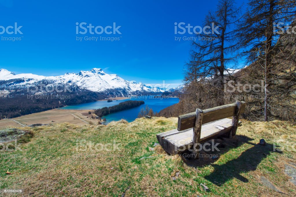 View of the Engadin valley from a wooden bench stock photo