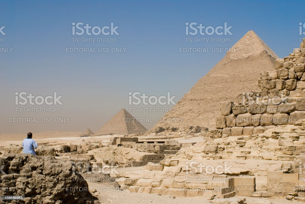 View of the Giza plateau with pyramids under blue sky royalty-free stock photo