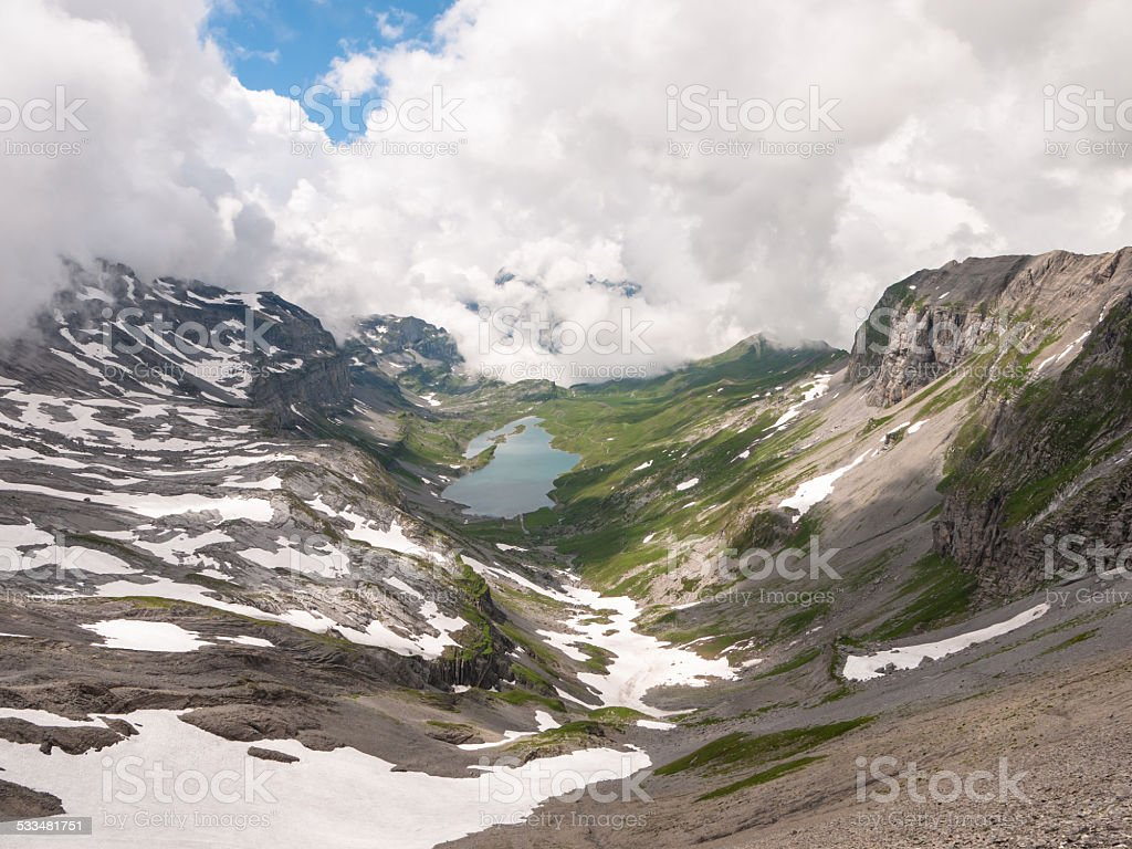 View of the Glattalpsee (lake) and valley from mountains stock photo