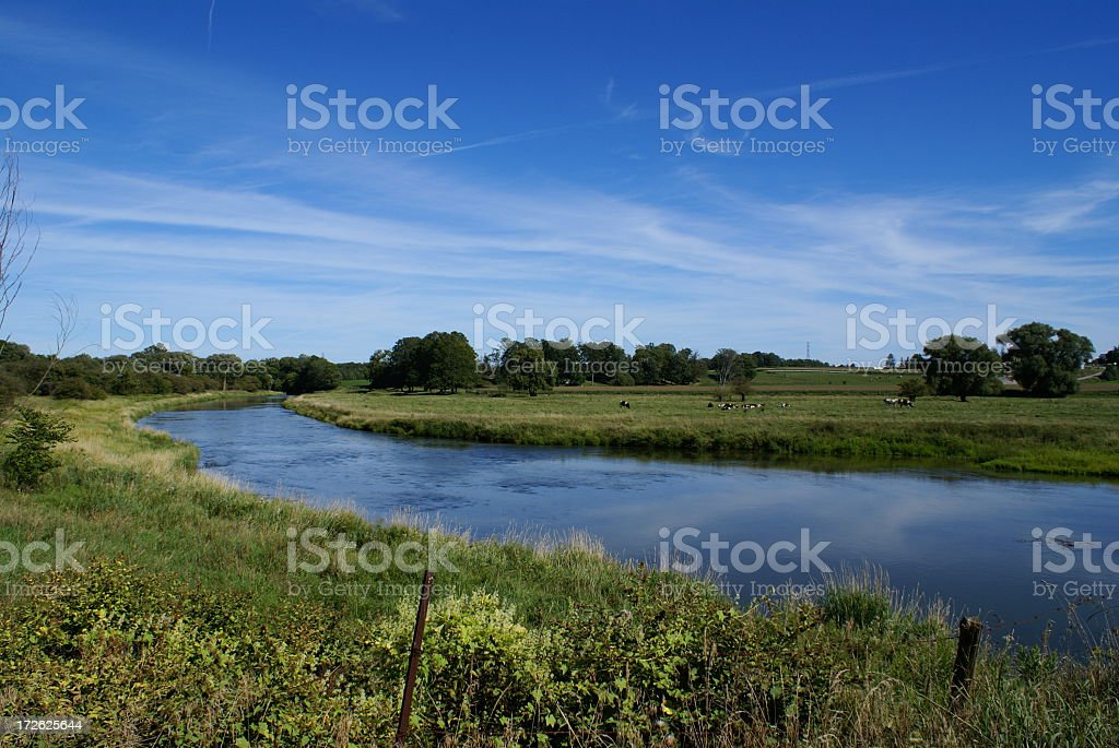 A view of the Grand River in Waterloo, Ontario on sunny day stock photo