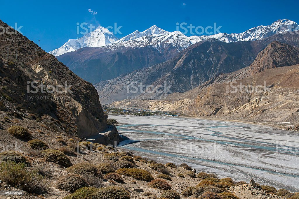 view of the Himalayas (Dhaulagiri) and the village of Jomsom stock photo