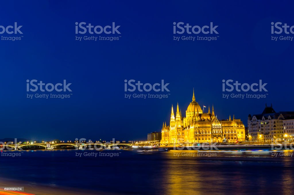 View of the illuminated Hungarian Parliament and Margaret Bridge in Budapest stock photo