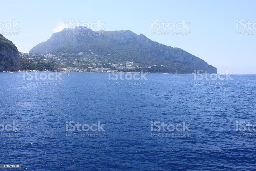 View of the island of Capri from the Tyrrhenian Sea. Campania, Italy. stock photo