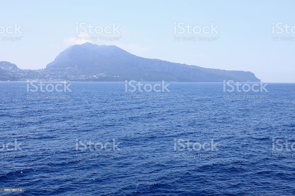View of the island of Capri from the Tyrrhenian Sea. Italy. stock photo