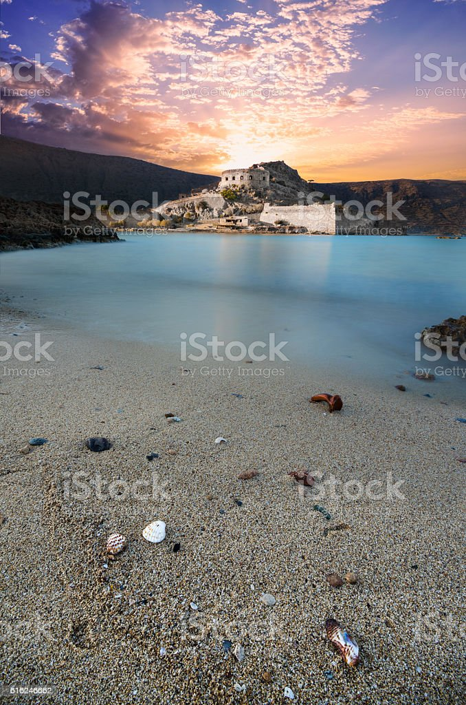 View of the island of Spinalonga at sunset. stock photo