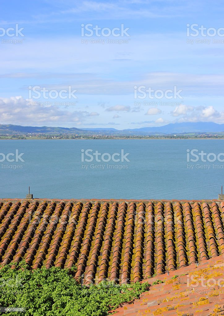 view of the lake from the roofs of a house stock photo