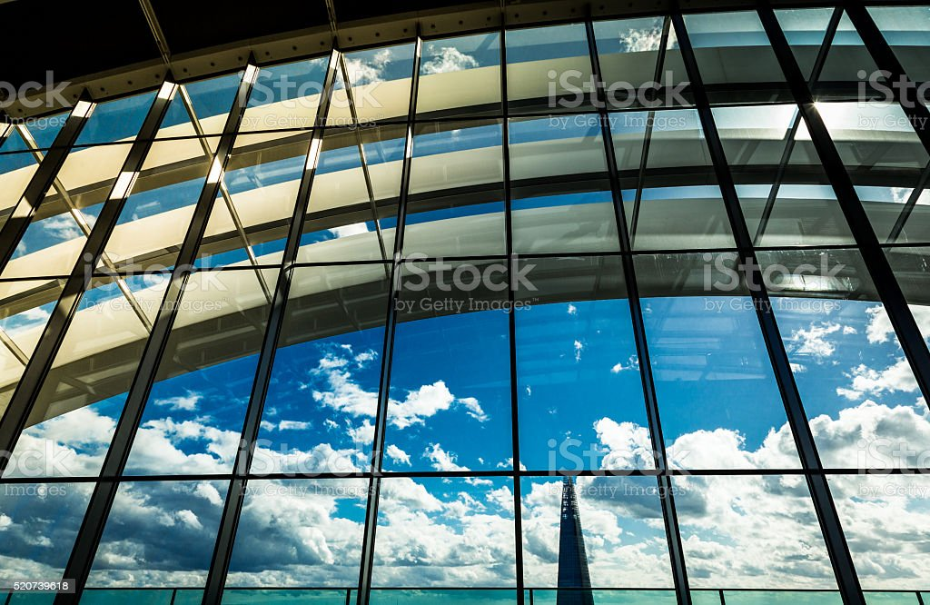 View of the London Skyline through glass window stock photo