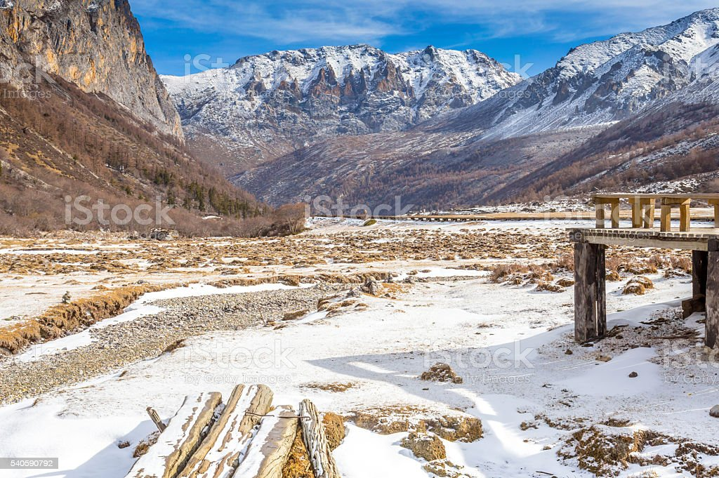 View of the mountains and snow field into the valley stock photo