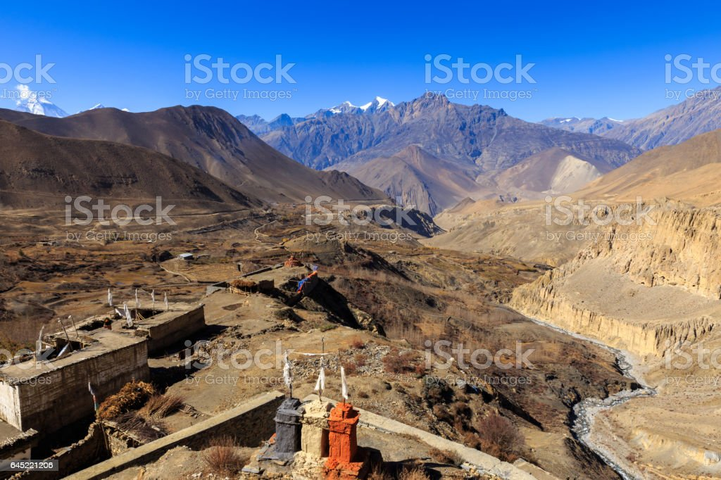 view of the mountains from the temple in the village jharkot stock photo