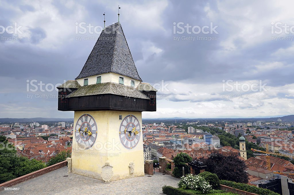 View of the old clock tower and the rooftops of Graz stock photo