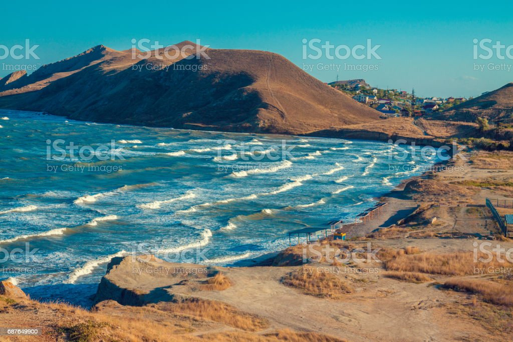 View of the open sea bay. Rocky seashore with blue sky. Beautiful nature. stock photo