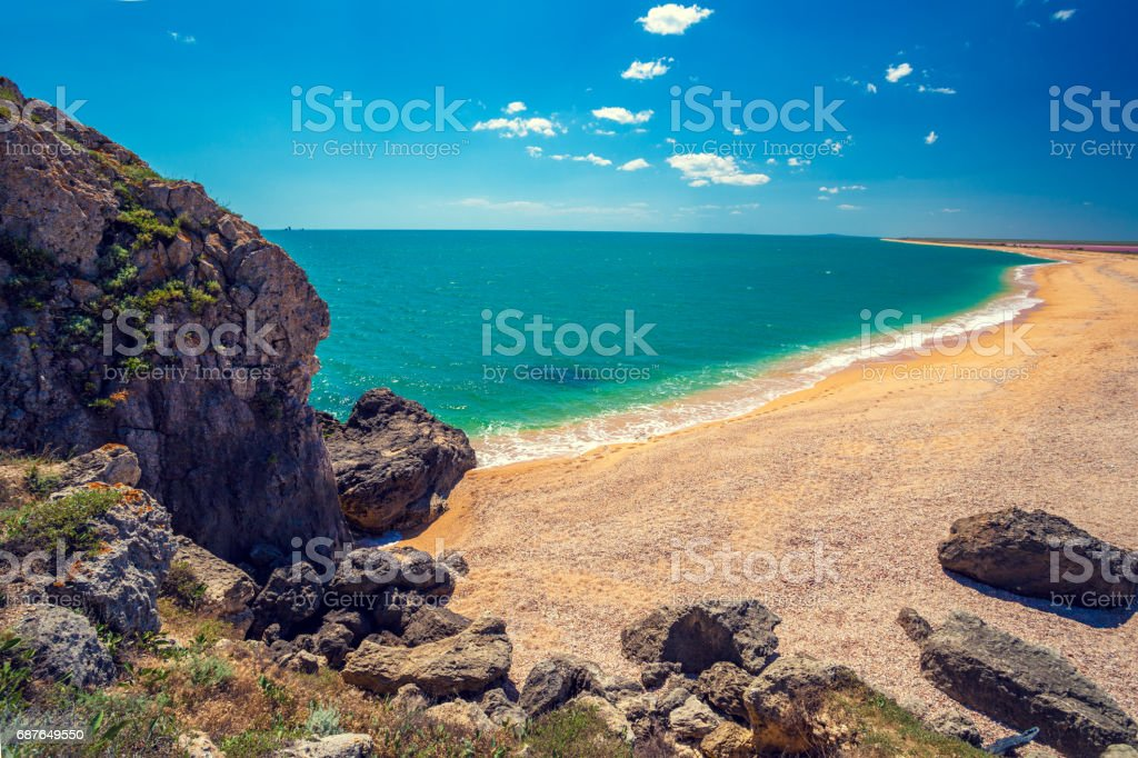 View of the open sea. Rocky seashore with blue sky. Beautiful nature. Deserted beach stock photo