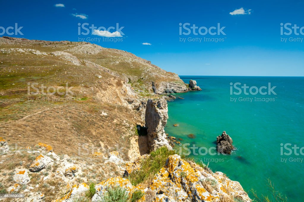 View of the open sea. Rocky seashore with blue sky. Beautiful nature stock photo