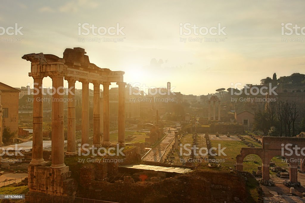 View of the Roman Forum with ruins, sunrise, warm sunlight stock photo