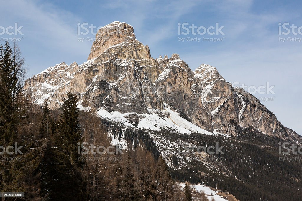 View of the Sassongher with snow in the Italian Dolomites stock photo