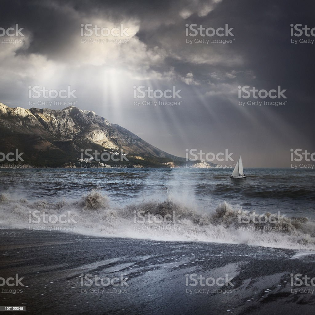 A view of the sea being covered by gray clouds and a storm royalty-free stock photo