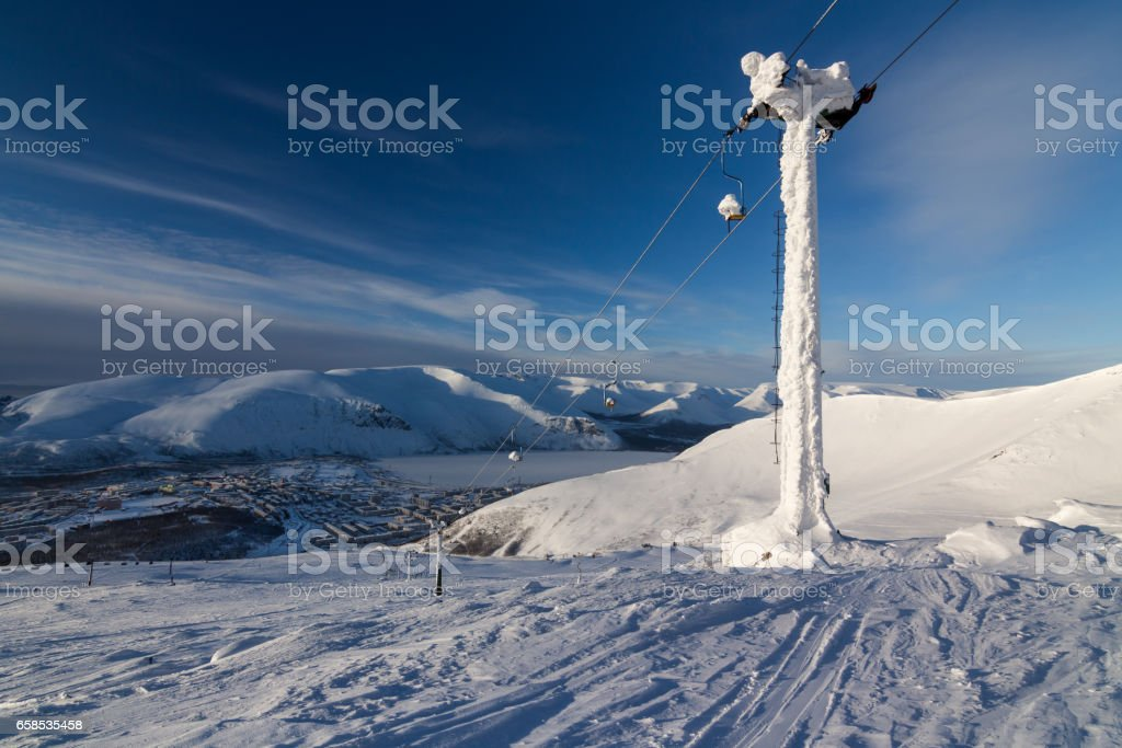 view of the ski resort and the city stock photo